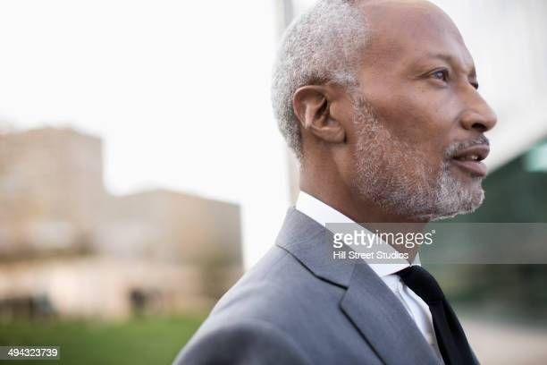 Black businessman standing outdoors