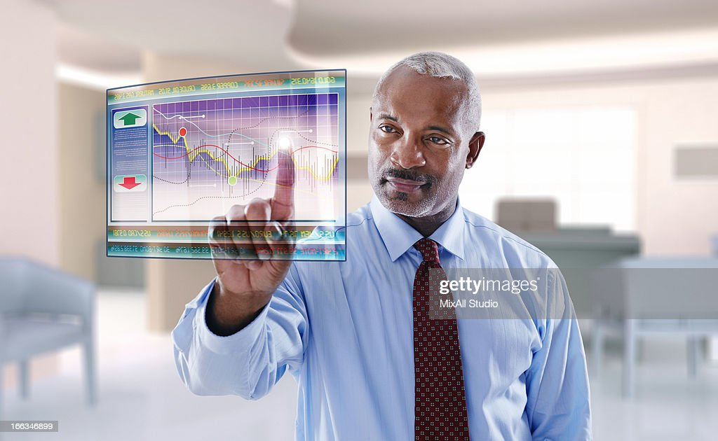 Black businessman using digital display : Stock Photo