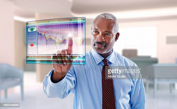 Black businessman using digital display