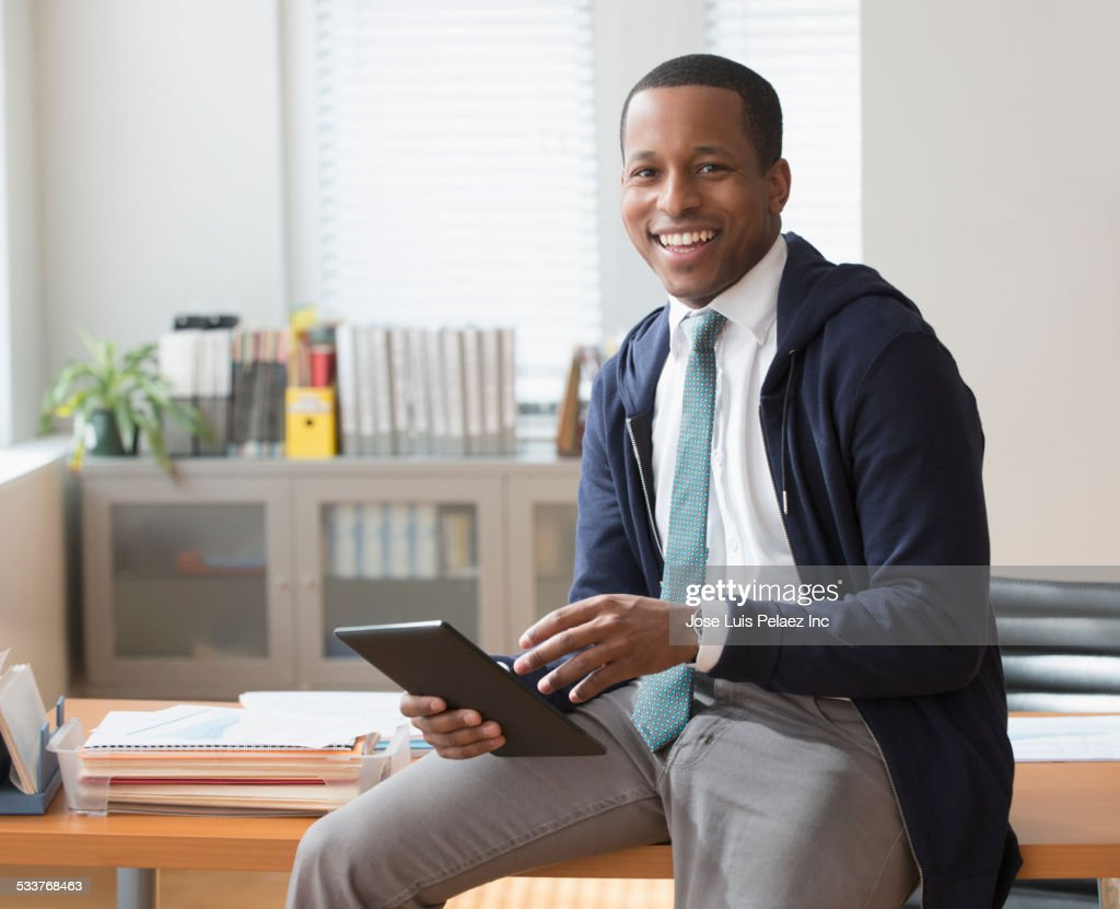 Black businessman using digital tablet in office : Foto stock