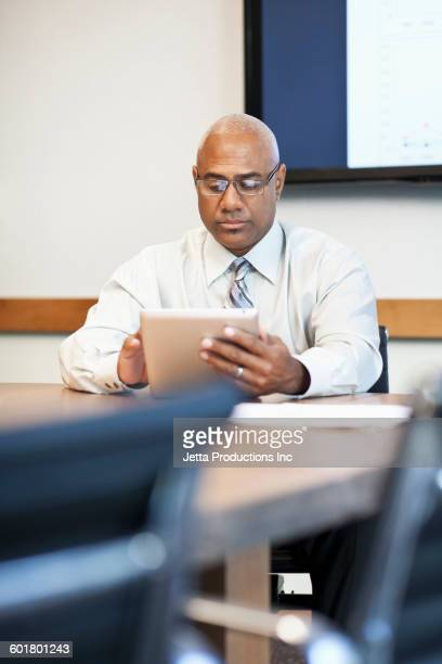 Black businessman using digital tablet in office