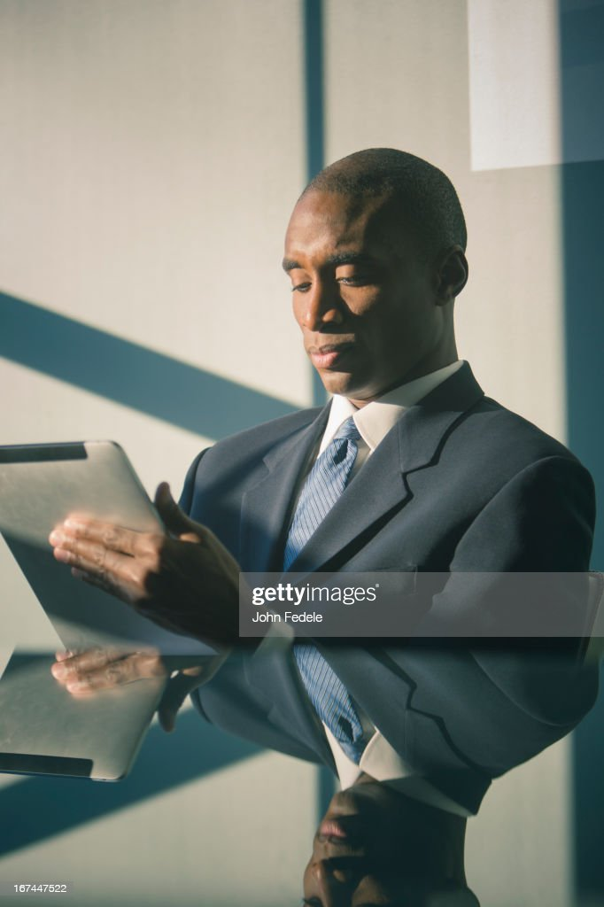 Black businessman using tablet computer : Stock Photo