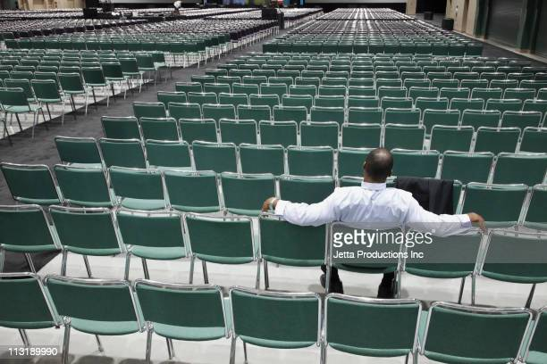black businessman waiting in empty conference center - attending stock pictures, royalty-free photos & images