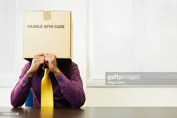 black businessman with box over his head - hangover stock photos and pictures