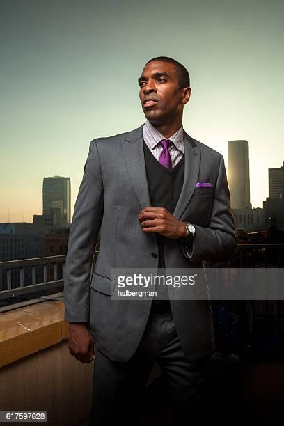 Black Businessman with Urban Skyline in Background