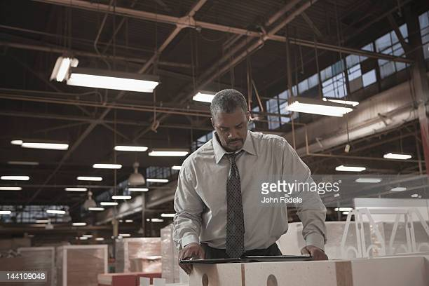 Black businessman working in warehouse