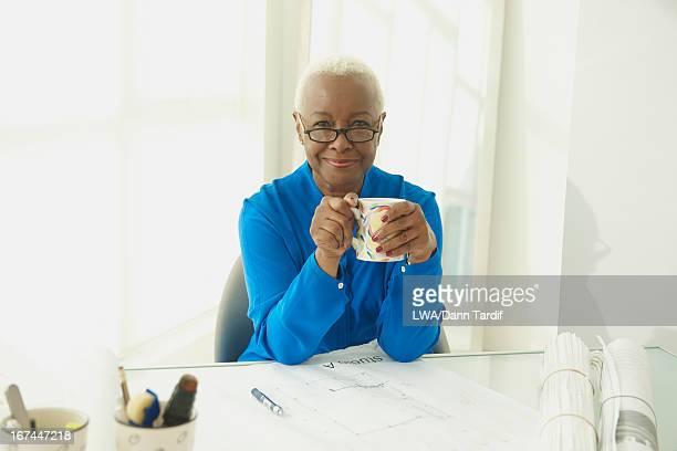 Black businesswoman drinking coffee