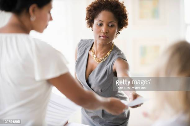Black businesswoman in meeting with co-workers