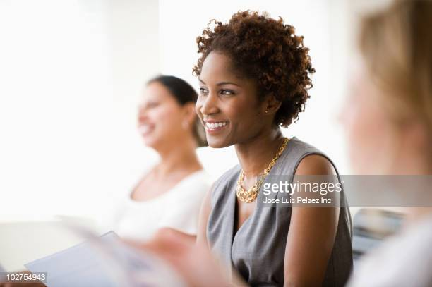 black businesswoman listening in meeting - multiculturalism stock pictures, royalty-free photos & images