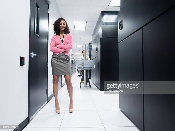 Black businesswoman standing in server room