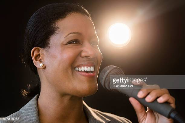 Black businesswoman talking into microphone