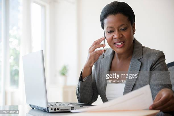 black businesswoman talking on cell phone - answering stock pictures, royalty-free photos & images