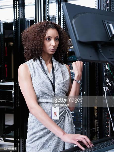 Black businesswoman working in server room