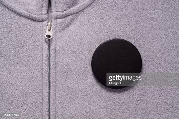 black button badge on gray cloth - campaign button stock pictures, royalty-free photos & images