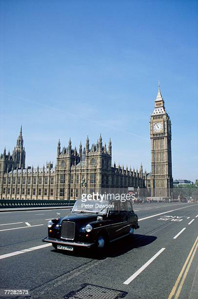 Black cab and Houses of Parliament in background