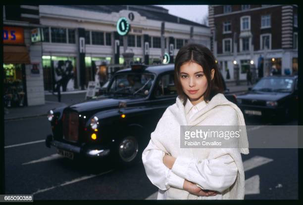 Black cab drives by as Jane March strolls through London's streets. The British actress plays the role of the young girl in French director...