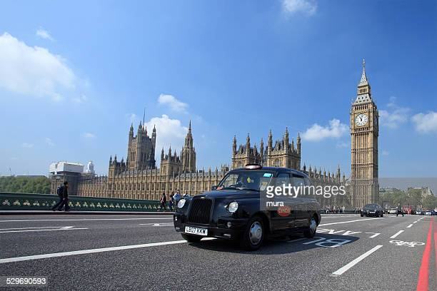 Black cab in front of the Parliament