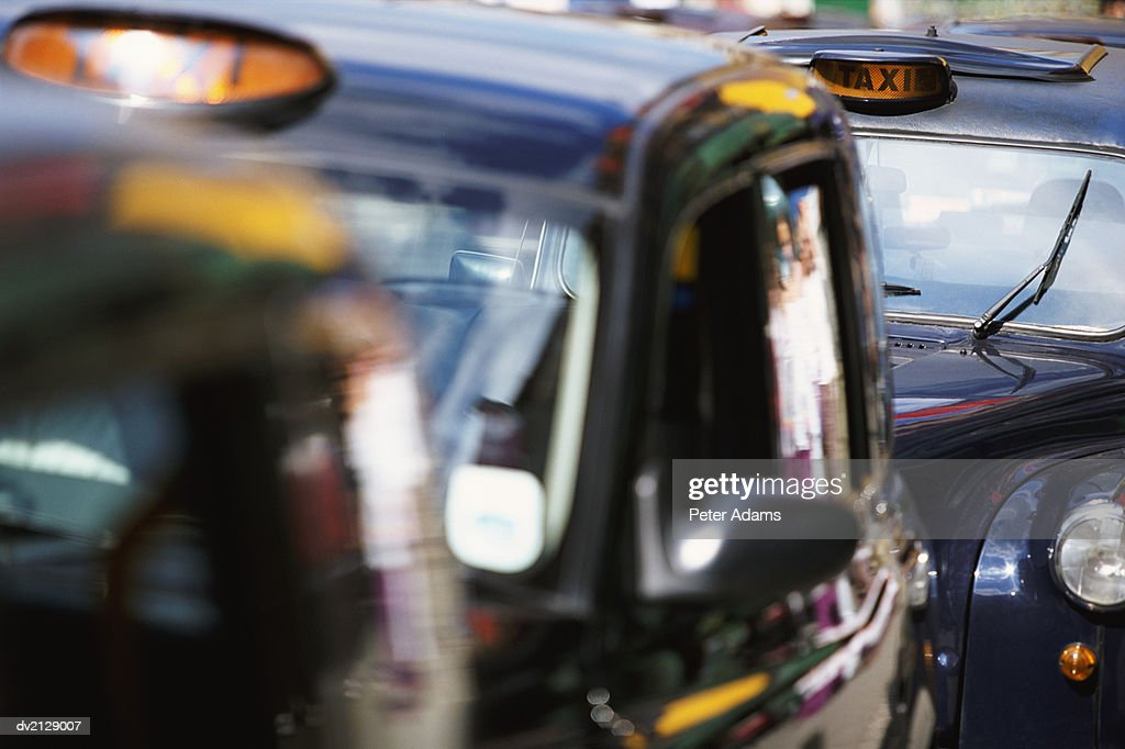 Black Cabs Parked in a Row : Stock Photo