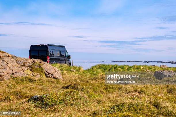 black campervan parked at a beautiful location in vesterålen norway - finn bjurvoll stock pictures, royalty-free photos & images