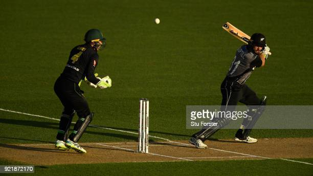 Black Caps batsman Martin Guptilll hits out watched by Australia wicketkeeper Alex Carey during the International Twenty20 Tri Series Final match...