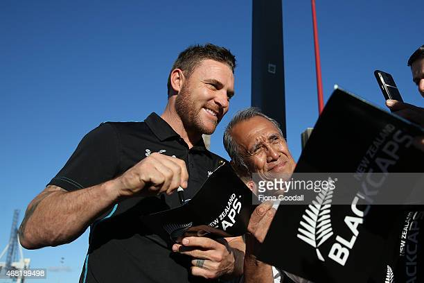 Black Caps captain Brendon McCullum signs autographs during the Zealand Blackcaps Welcome Home Reception at Queen's Wharf on March 31 2015 in...