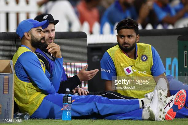 Black Caps captain Kane Williamson chats to India captain Virat Kohli and Rishabh Pant during game five of the Twenty20 series between New Zealand...