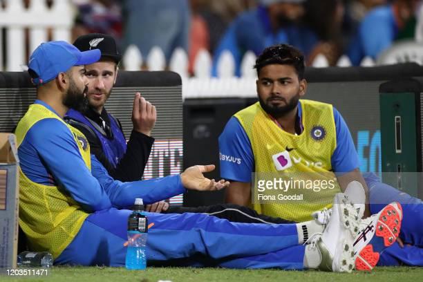 Black Caps captain Kane Williamson chats to India captain Virat Kohli and Rishabh Pant during game five of the Twenty20 series between New Zealand...