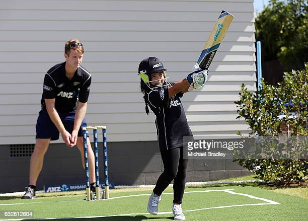 Black Caps Jimmy Neesham watches on as Regan BrabantHenry aged 7 hits the ball from Mangere after returning home to find the ultimate family cricket...