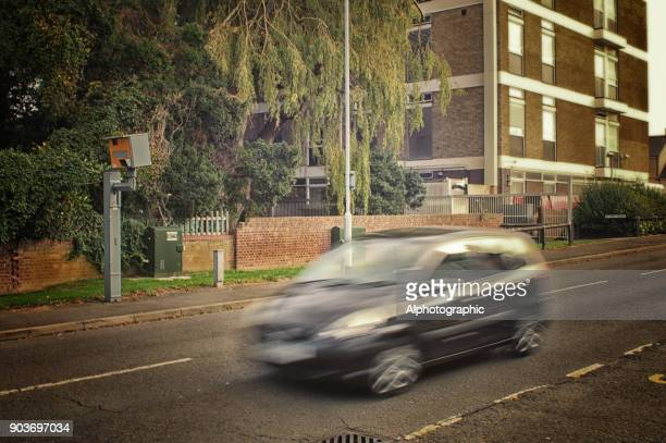 black car and speed camera - speed limit sign stock photos and pictures