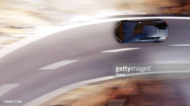 black car driving on a mountain road - sports car stock pictures, royalty-free photos & images