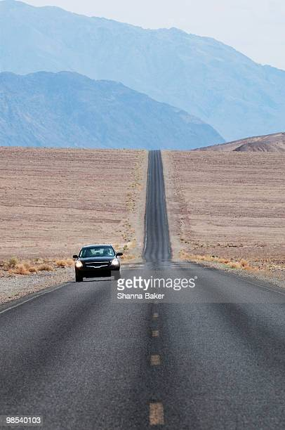 Black car on a road in Death Valley
