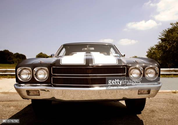 black car on road against sky - bumper stock pictures, royalty-free photos & images