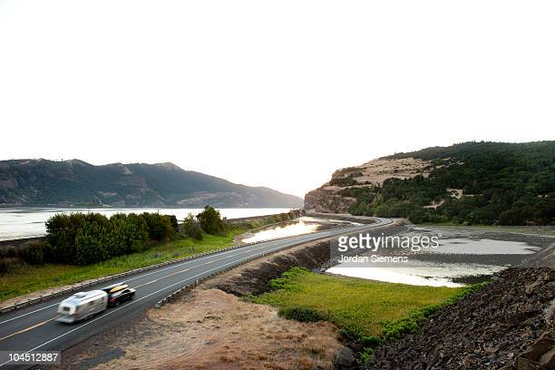 black car towing a silver motorhome. - columbia river gorge stock pictures, royalty-free photos & images