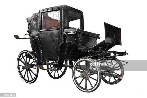 Black carriage without horse pulling it