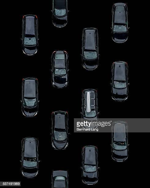 Black cars on black ground, Aerial View