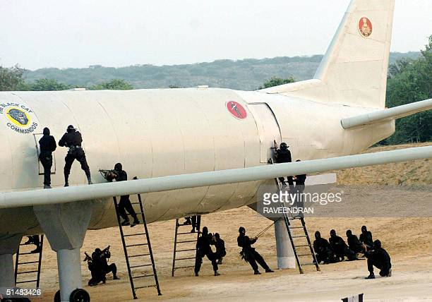 Black cat commandos from India's National Security Guard go through their paces on a mock aircraft on an Anti-Terrorist conditioning course during...
