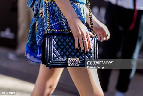 Black Chanel bag outside By Johnny at Mercedes-Benz Fashion Week Resort 17 Collections at Carriageworks on May 17, 2016 in Sydney, Australia.