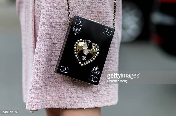 A black Chanel bag outside Chanel during Paris Fashion Week Haute Couture F/W 2016/2017 on July 5 2016 in Paris France