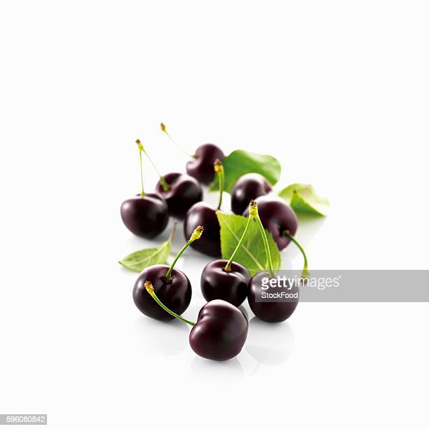 Black cherries with stem and leaves