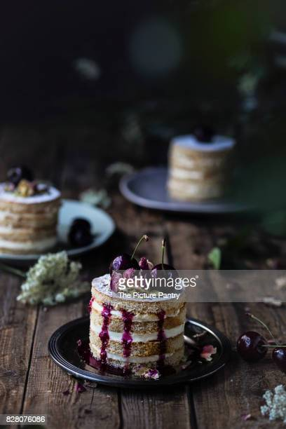 Black cherry cake on wooden table
