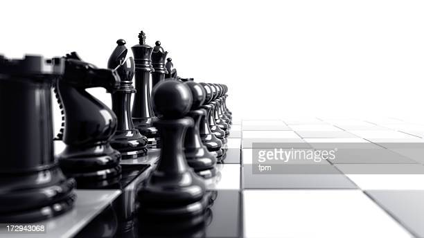 black chess pieces aligned on the left side of the board - conflict stock pictures, royalty-free photos & images