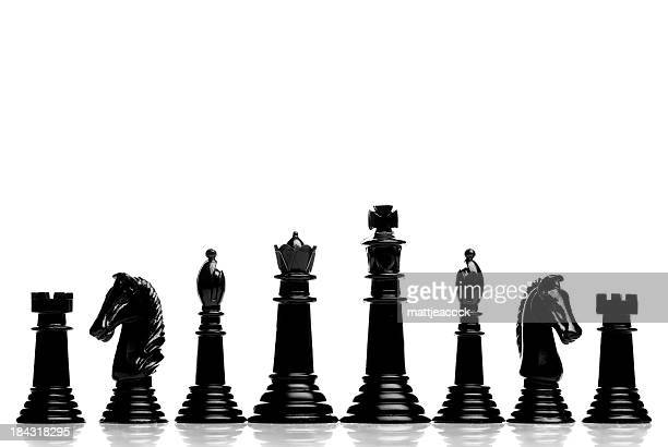 black chess pieces - chess piece stock pictures, royalty-free photos & images