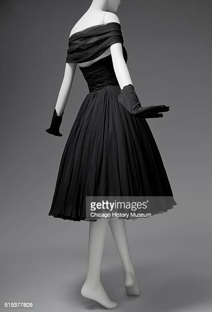 Black chiffon cocktail dress designed by James Galanos and distributed by Blum's Vogue Chicago Illinois 1958 Shown as part of the Chicago History...