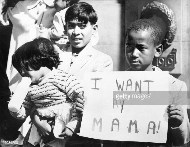 A black child demonstrates to have his mother released in May 1960 in front of Johannesburg's city hall These last weeks more than 500 native South...