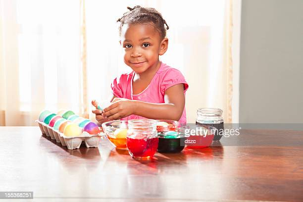 Black Child Dyeing Easter Eggs