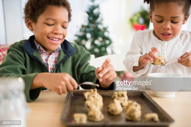 Black children baking cookies together