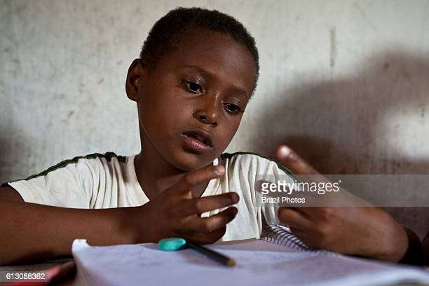 Black children have reinforcement class at home at Agrovila Maruda a Quilombo in Alcantara Maranhao State Northeastern Brazil 12years old boy...