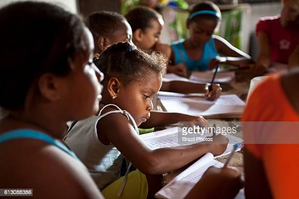 Black children have reinforcement class at home at Agrovila Maruda a Quilombo in Alcantara Maranhao State Northeast Brazil a quilombo is a Brazilian...
