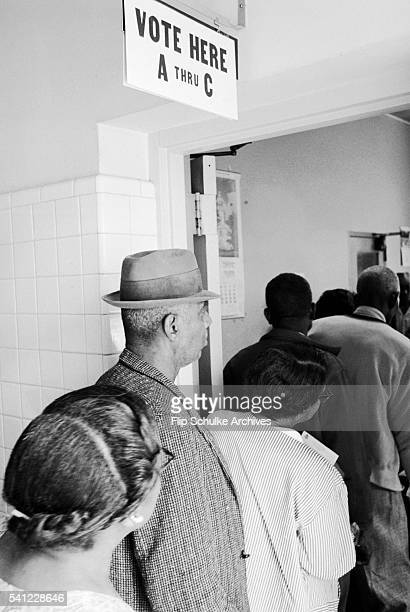Black citizens wait in line to vote for the first time in Alabama after enactment of the Voting Rights Act.