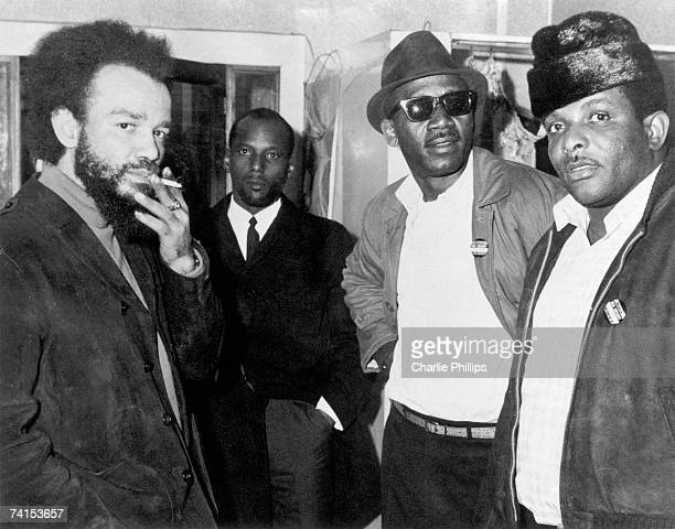 Black civil rights activist Michael X at the Tabernacle Notting Hill London 1966 Left to right Michael X Bobby Stignac Archie Seaforth and...